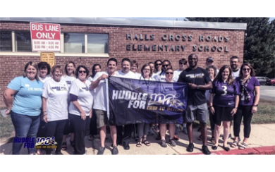 Volunteers help Ravens Huddle for 100 at Hall's Cross Elementary